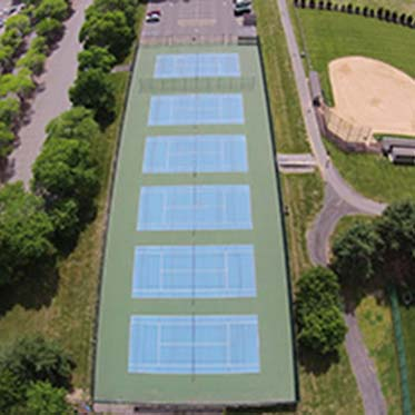 Aerial View of Row of Tennis Courts