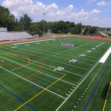Aerial View of Turf Field and Running Track in High School