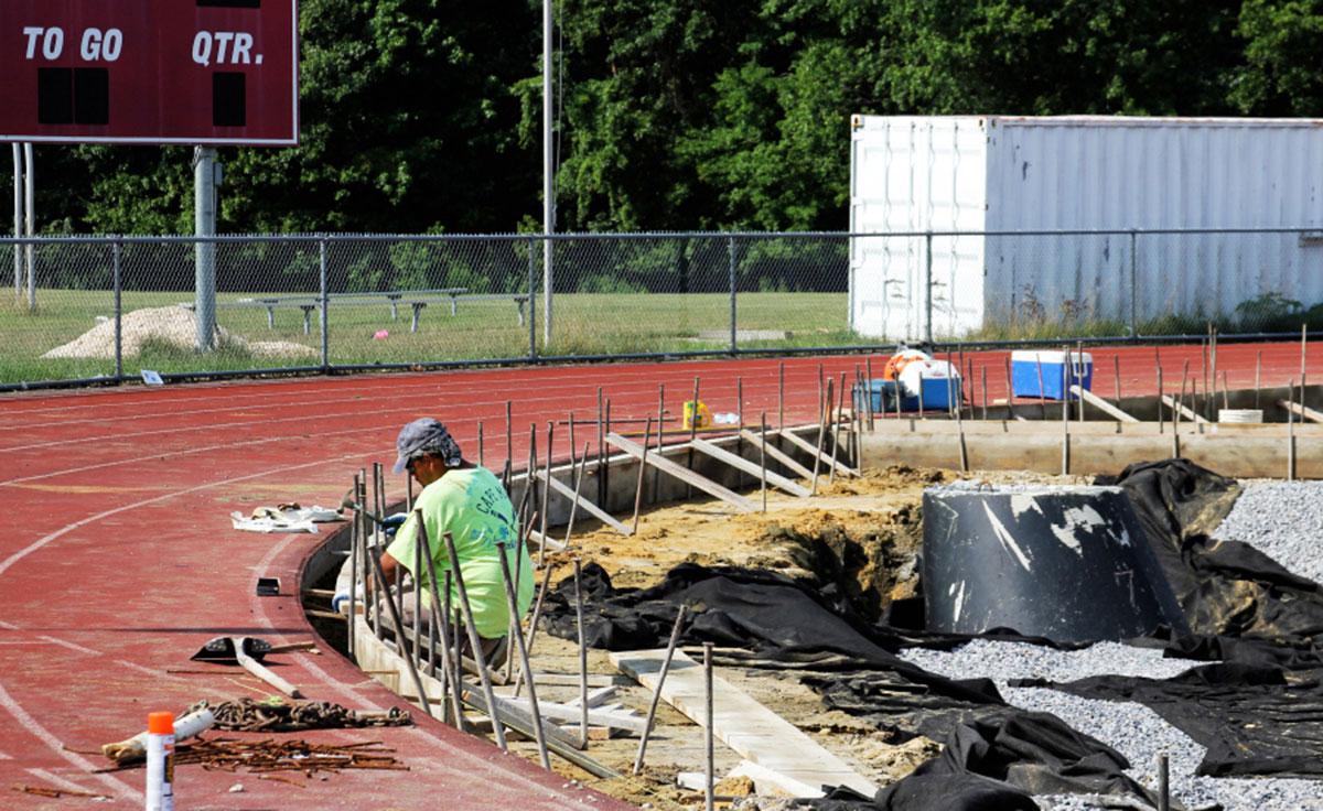 Repair Professional Working On Running Track