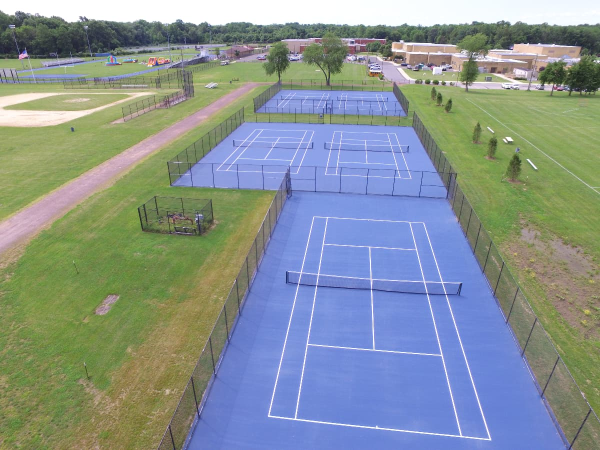 track and turf tennis courts